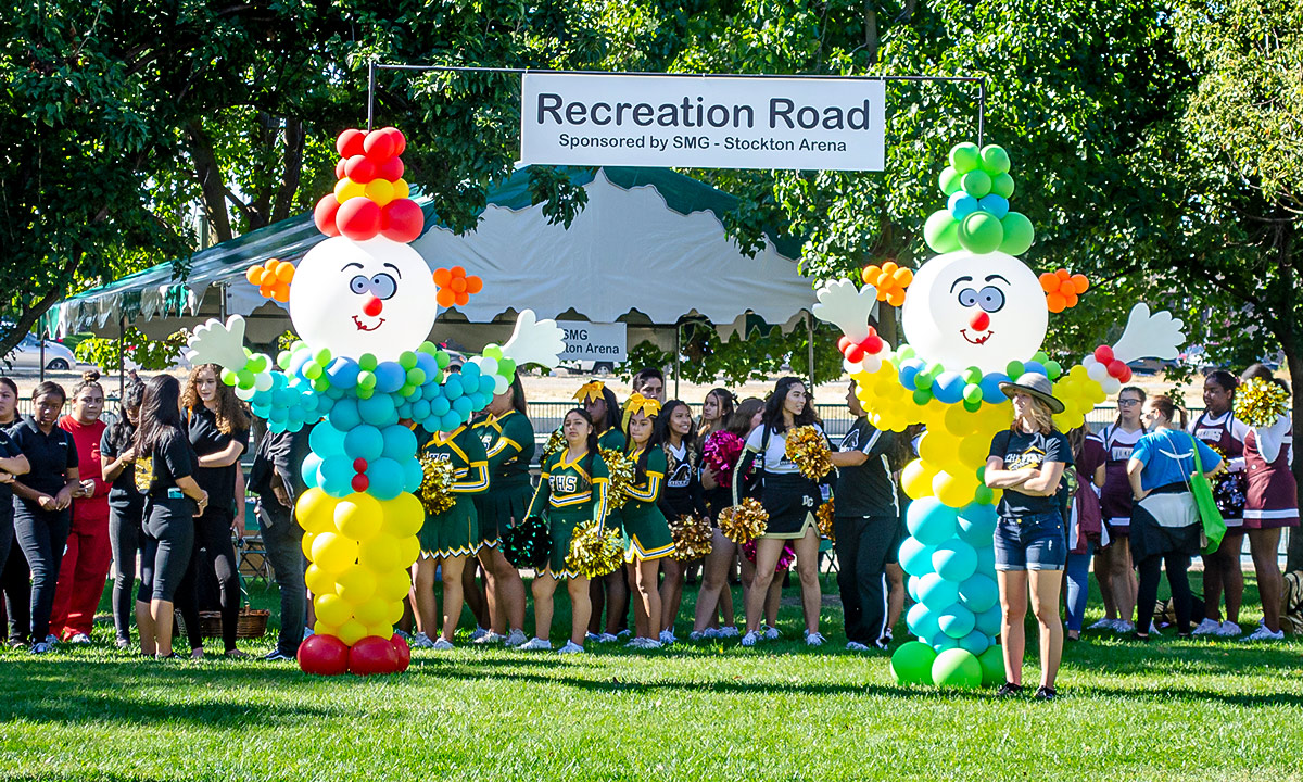 Parade participants lined up behind the Recreation Road sign